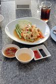 pic of green papaya salad  - green papaya salad in white dish on the foods table - JPG