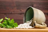 Fresh Parsley And Beans On Wooden Background