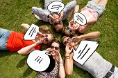 friendship, leisure, summer, message and people concept - group of smiling friends lying with text b