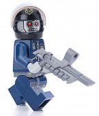 Ankara, Turkey - February 12, 2014 : Lego movie minifigure character Robo Swat walking isolated on w