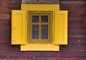 Yellow Window On Wooden Wall