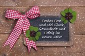 stock photo of red clover  - Greeting card for christmas and happy new year with clovers in country style  - JPG