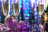 Glasses of champagne and Christmas ball