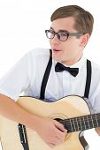Nerdy hipster playing the guitar on white background