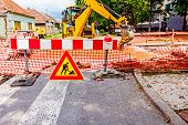 image of reconstruction  - Road signs in a street under reconstruction symbol - JPG
