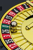 the cylinder of a roulette gambling in a casino. winning or losing is decided by chance. number zero, lost everything