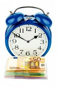 an alarm clock and banknotes, symbolic photo for wage costs, labor costs, time work