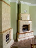 Retro style room with two tiled stoves