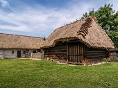 Typical old style Polish farmstead with thatched roofs