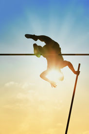 picture of light-pole  - Pole vault over the bar with back light - JPG