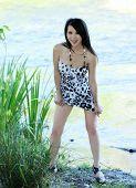 Skinny Asian American Woman Outdoors Short Dress