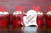 Happy Valentine Red Velvet Cupcakes With Love Messages On Red Vintage Wood Background, With Greeting