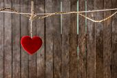 Red Heart With Clothespin Hanging On Clothesline