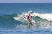 Surfer girl on the wave