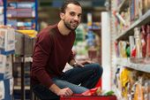image of department store  - Handsome Young Man Shopping For Fruits And Vegetables In Produce Department Of A Grocery Store - Supermarket - Shallow Deep Of Field