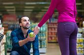 picture of department store  - Beautiful Young Couple Shopping For Fruits And Vegetables In Produce Department Of A Grocery Store  - JPG
