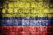 Colombia flag on brick wall