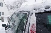 Car In The Winter Covered With Snow