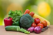 Variety Of Fresh Vegetables On Wood Table