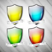 Empty isolated colored shields on dirty gray background. Vector format