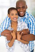 handsome african american man hugging pretty girlfriend