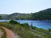 foto of luka  - The footpath along the entrance of the hidden bay of the island Lastaovo in the Adriatic sea of Croatia - JPG
