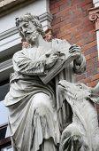 VIENNA, AUSTRIA - OCTOBER 10: Saint Luke the Evangelist on the facade of Evangelical School in Vienna, Austria on October 10, 2014.