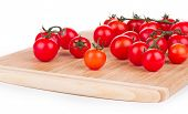 Cutting board with tomatoes cherry.