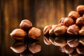 Hazelnuts, filbert on wooden background. Selective focus