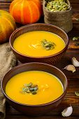 Pumpkin soup on rustic wooden table, selective focus