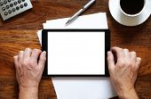 Digital tablet pc on business desk with blank white screen