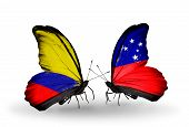 foto of samoa  - Two butterflies with flags on wings as symbol of relations Columbia and Samoa - JPG