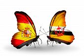 Two Butterflies With Flags On Wings As Symbol Of Relations Spain And Brunei