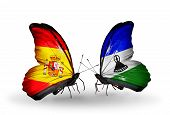 Two Butterflies With Flags On Wings As Symbol Of Relations Spain And Lesotho