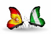Two Butterflies With Flags On Wings As Symbol Of Relations Spain And Nigeria