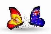 Two Butterflies With Flags On Wings As Symbol Of Relations Spain And New Zealand