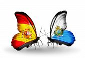Two Butterflies With Flags On Wings As Symbol Of Relations Spain And San Marino