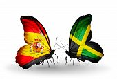 foto of spanish money  - Two butterflies with flags on wings as symbol of relations Spain and Jamaica - JPG