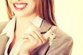 Young business caucasian woman is holding house keys.