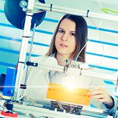 A student girl print prototype on  3D printer