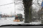 A Tractor On A Road During A Snow Storm