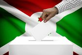 pic of burundi  - Ballot box with national flag on background  - JPG