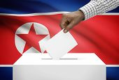 Ballot Box With National Flag On Background - North Korea