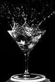 Olives Splashing on a Martini Glass