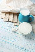 Homemade yogurt and tasty Tasty crispbread on wooden table background