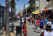 Crowds Visit The Stalls On Venice Beach Boardwalk.