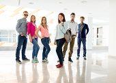 Cheerful students standing in hallway high school