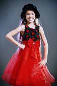 Portrait of a cute teen girl wearing beautiful festive dress. Beauty, children's fashion. Studio shot.