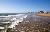 stock photo of tide  - incomming tide at durban beach with hotels in background - JPG