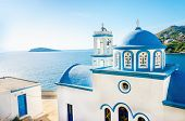 picture of greek  - Typical Greek blue dome of white church with sea view in sunny day  - JPG